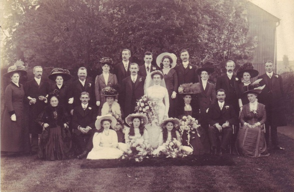 "Wedding of Ethel Lizzie Moody and Sidney Butler 21.10.1909. Back row L to R: Winnie Butler, Frank Hillary, Florence Butler, Earl White (brother of Susan White), Mrs F Hillary, James Butler Moody, Maurice Butler, Gertrude Butler, Frank Moody, Mabel Barlow, Tom Barlow, Beatrice Butler, Frank Butler  Middle row L to R: Mary Corbishley, Bertie Butler, Elizabeth Moody, Sidney Butler, Ethel Butler, Susan Butler (nee White). Arthur Moody, ""Aunt Sophia"" who may be Edith Sophia Paice"